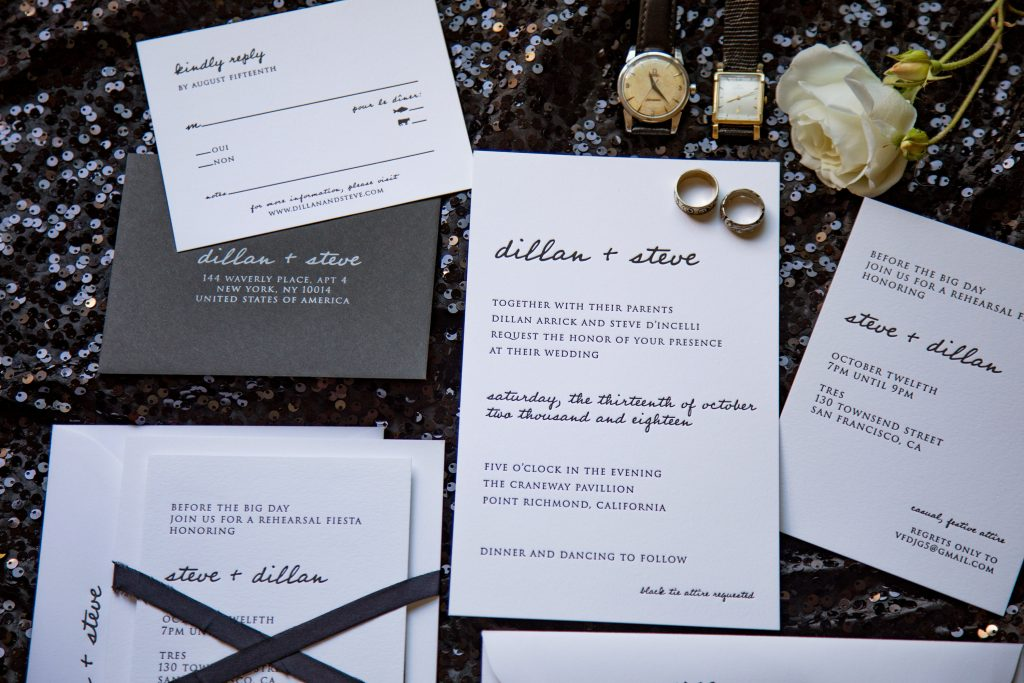 Flat lay of a letterpress wedding invitation suite in black and white for a modern black tie wedding.