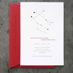 A very clean, simple take on a constellation / zodiac wedding invitation; letterpress printed in black and red with corresponding red envelope; clean sans serif type, gemini constellation