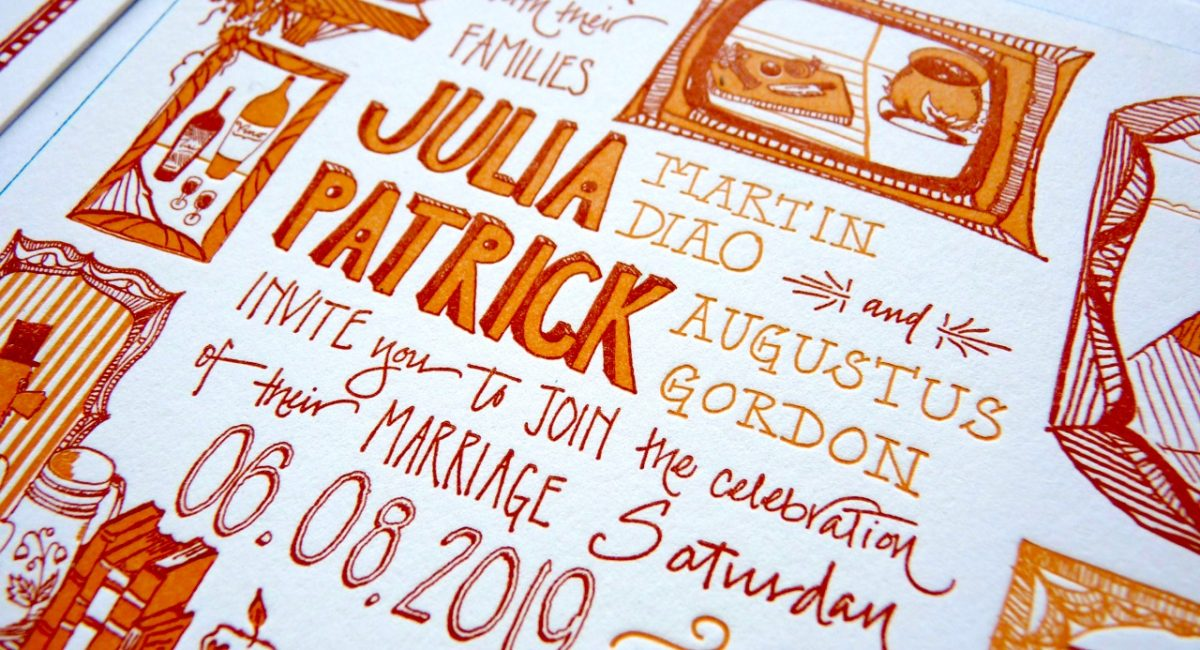 Unique letterpress printed wedding invitation with hand drawn lettering and custom illustrations in rust and orange colors