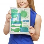 Smiling young woman holding empty white board. Isolated